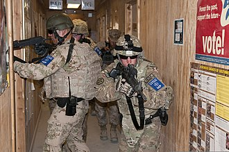 Insider threat - U.S. Army military police officers clear a building during an insider threat exercise at Kandahar Airfield, Afghanistan, May 23, 2013. Soldiers with the 311th Expeditionary Sustainment Command conducted the training to prepare for the possibility of an active shooter.