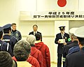 U.S. Navy Capt. Chris Rodeman, left, the commanding officer of Naval Air Facility Misawa, participates in a ceremony before a joint downtown patrol of Misawa, Japan, Dec. 17, 2013 131217-N-DP652-021.jpg