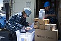 U.S. Navy Chief Hospital Corpsman Kona Wilson, left, and Hospital Corpsman 3rd Class Thomas Torgerson count medical supplies for Pacific Partnership 2013 aboard the amphibious dock landing ship USS Pearl Harbor 130507-N-WD757-020.jpg