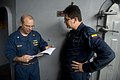 U.S. Navy Cmdr. Charles Wilson, left, and Colombian Navy Lt. Hernan Castro discuss medications during a medical meeting aboard the amphibious dock landing ship USS Pearl Harbor (LSD 52) in the Pacific Ocean 130531-N-WD757-085.jpg