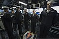 U.S. Navy Cmdr. Dave Stoner, left background, the commanding officer of the guided missile destroyer USS Ramage (DDG 61), conducts a dress uniform inspection of culinary specialists aboard the ship Nov. 14 131114-N-VC236-007.jpg