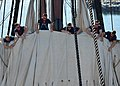 U.S. Sailors assigned to the three-masted heavy frigate USS Constitution furl the topsail on the main mast of the ship as part of sail training in Charlestown, Mass., Aug. 7, 2012 120807-N-BJ178-679.jpg