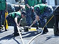 U.S. Sailors secure mooring lines aboard the attack submarine USS Jacksonville (SSN 699) as the submarine arrives for maintenance in Apra Harbor, Guam, April 9, 2013 130409-N-LS794-120.jpg