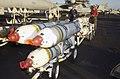 US Navy 030308-N-4142G-008 Aviation Ordnanceman 2nd Class Mike Mock inspects three PDU-5 Leaflet Bombs.jpg
