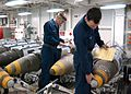 US Navy 030320-N-5292M-005 Aviation Ordnancemen inspect a Joint Direct Attack Munition (JDAM) GBU-31 in preparation for loading on air wing aircraft.jpg