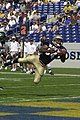 US Navy 030920-N-9693M-005 Navy junior slot back Eric Roberts scores as he falls into the endzone against Eastern Michigan University (EMU).jpg
