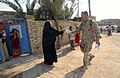 US Navy 031016-N-3236B-035 Sailors and Marines from Expeditionary Strike Group One (ESG-1) distribute water to the people of Al Faw, Iraq.jpg
