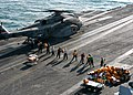 US Navy 040102-N-9742R-001 Personnel from the Air Transport Office, Post Office, and Supply Department unload mail and cargo from a MH-53E Sea Dragon assigned to the Blackhawks of Helicopter Mine Countermeasures Squadron One Fi.jpg