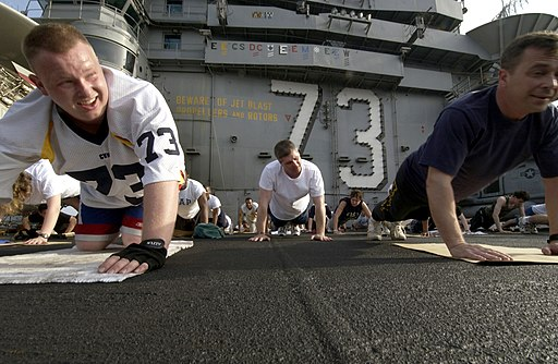 US Navy 040327-N-5319A-006 Sailors aboard USS George Washington (CVN 73) take the opportunity to workout on the flight deck during a no-fly day while operating in the Arabian Gulf