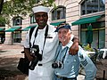 US Navy 040528-N-9909C-001 Photographer's Mate 2nd Class Corey Lewis, left, poses with World War II veteran Stephen E. Kanyusik during the Navy's Battle of Midway Memorial Ceremony at the Navy Memorial in Washington.jpg