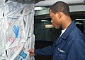 US Navy 040616-N-9621S-006 Operation's Specialist Seaman Kyran Lane of Wilson, N.C., looks at artwork made by the George Washington Family Support Group.jpg