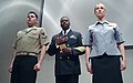 US Navy 041208-N-0962S-009 Chief of Naval Operations-directed Command Master Chief Robert B. Carroll, center, introduces the year-round concept service uniforms for Sailors E-6 and below.jpg