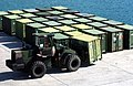 US Navy 051010-M-0596N-001 A tractor moves a quadcon container at Kin Red Port in Okinawa.jpg