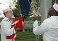 US Navy 051010-N-9458H-002 Air Traffic Controller 2nd Class Michael Call and Yeoman 2nd Class Tony Bennett raise the presidential flag on board Naval Air Station Joint Reserve Base (NAS JRB) New Orleans.jpg