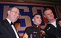 US Navy 060322-F-5107H-025 Joint Chiefs of Staff Vice Chairman, Adm. Edmund Giambastiani presents Marine Corps Sgt. Michael Donnelly and Petty Officer 3rd Class Justin Ledsome with a USO award for their service in Iraq.jpg