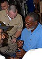 US Navy 070613-N-5268S-005 Lt. Fredrick Wissen, engineering officer USS Albany (SSN 753) gets autographs from the legendary L.C. Greenwood, a former star of the Pittsburgh Steelers.jpg