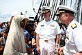 US Navy 070704-N-8110K-002 Vice Adm. Paul Sullivan, commander of Naval Sea Systems Command, speaks to America's newest citizen, Nuro Ahmed Warsame of Somalia, aboard USS Constitution during her Independence Day turnaround.jpg