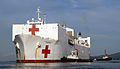US Navy 070922-N-0194K-222 Military Sealift Command hospital ship USNS Comfort (T-AH 20) is pushed from the pier by tugboats after completing nearly a week of medical aid in Trinidad and Tobago.jpg