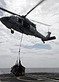 US Navy 080718-N-4236E-436 An MH-60S Seahawk assigned to Sea Combat Squadron (HSC) 28 brings mail, supplies and food aboard the guided-missile cruiser USS Vella Gulf (CG 72).jpg