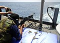 US Navy 080725-N-4236E-163 Operations Specialist 3rd class Jaron Reid shoots a M240B machine gun off the fantail of the guided-missile cruiser USS Vella Gulf (CG 72). Vella Gulf is participating in a Joint Task Force Exercise 0.jpg