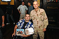 US Navy 081209-N-9769P-179 Charles James Shaffer accepts a memento of his visit to Guantanamo Bay.jpg