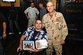 US Navy 081209-N-9769P-179 Charles James Shaffer accepts a memento of his visit to Guantanamo Bay.jpg