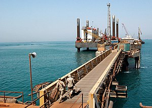 Economy of Iraq - Image: US Navy 090328 N 0803S 012 Sailors walk along Iraq's Khawr Al Amaya Oil Platform (KAAOT). U.S. and Coalition forces guard the Khawr Al Amaya Oil Platform