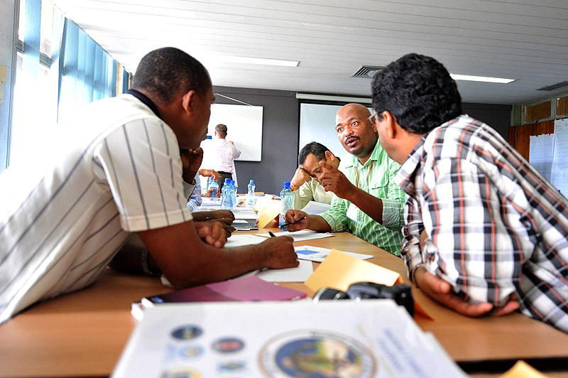 File:US Navy 090806-N-2420K-003 Comoros Army 2nd Lt. Moudjib Rahmane Adaine, left, South African Senior Superintendent Sindile Terrence Gxasheka and Yemeni Navy Lt. Col. Mohammed Salmin Batais discuss a scenario involving an oil spi.jpg