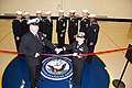US Navy 091113-N-7434T-045 Lt. Cmdr. Kim Pizanti and Chief Damage Controlman Martin Remle perform a ribbon cutting ceremony.jpg