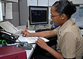 US Navy 091117-N-0659H-001 Aviation Ordnanceman 1st Class La`Toya Dudley prepares to write orders for junior Sailors.jpg