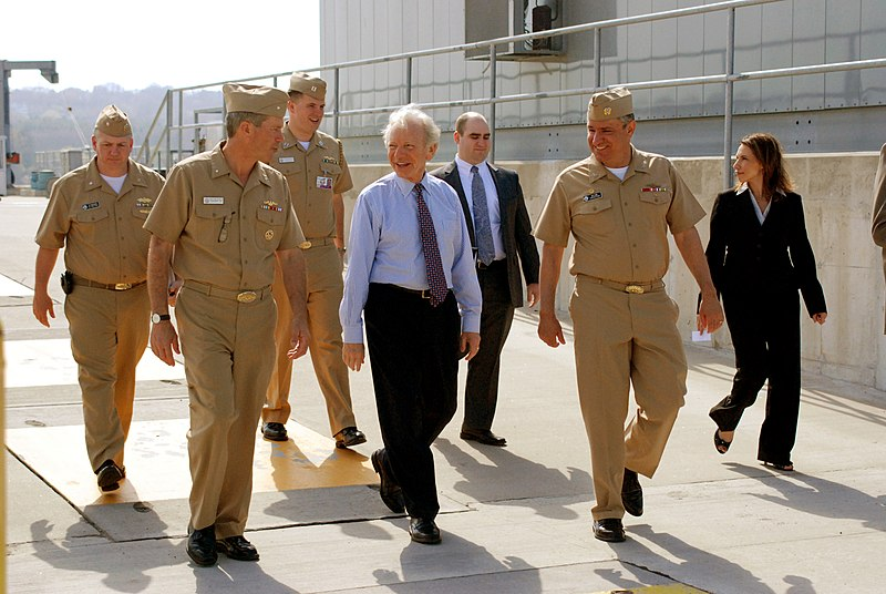 US Navy 100408-N-4437G-217 Senator Joe Lieberman, center, speaks with Rear Adm. Michael E. McLaughlin, left, and Capt. Marc W. Denno during a tour of SUBASE New London.jpg