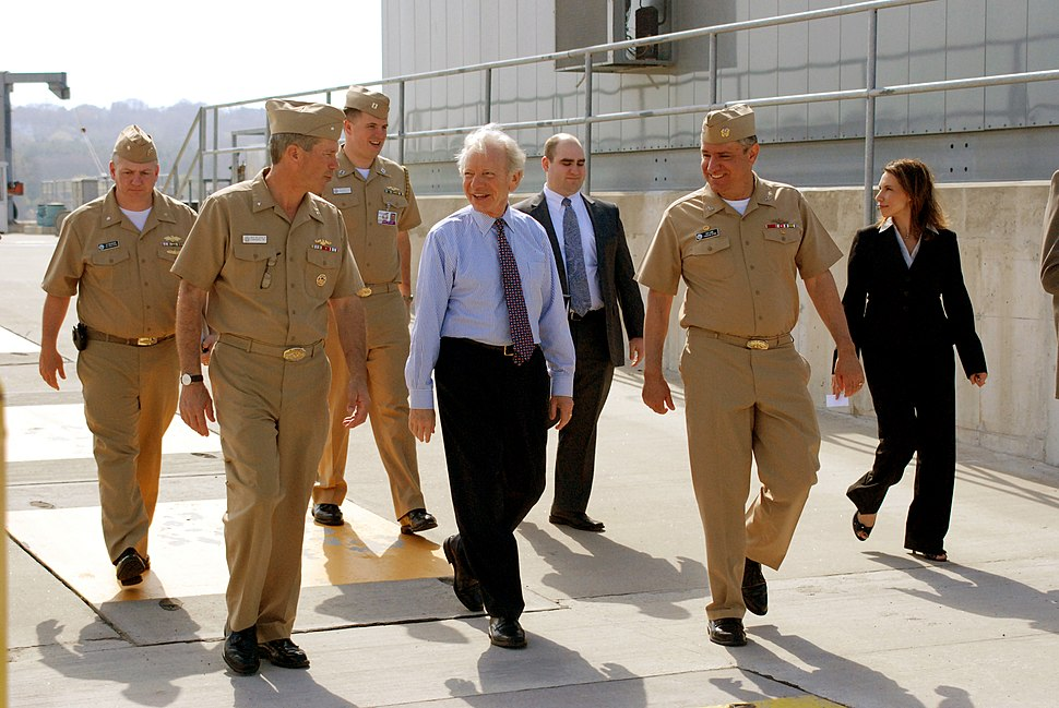 US Navy 100408-N-4437G-217 Senator Joe Lieberman, center, speaks with Rear Adm. Michael E. McLaughlin, left, and Capt. Marc W. Denno during a tour of SUBASE New London