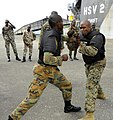 US Navy 100510-N-9643W-733 U.S. Marine Sgt. Geormon Elder spars with a member of the Jamaica Defense Force during the practical portion of the Marine Corps Martial Arts exchange with Marines.jpg