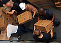 US Navy 100827-N-4044H-192 Sailors embarked aboard HMAS Tobruk (L 50) separate a pallet of medical supplies.jpg