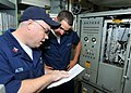 US Navy 101023-N-6632S-013 Fire Controlman 1st Class Scott M. Altis, left, and Fire Controlman 3rd Class David M. Lazcos perform pre-fire checks f.jpg