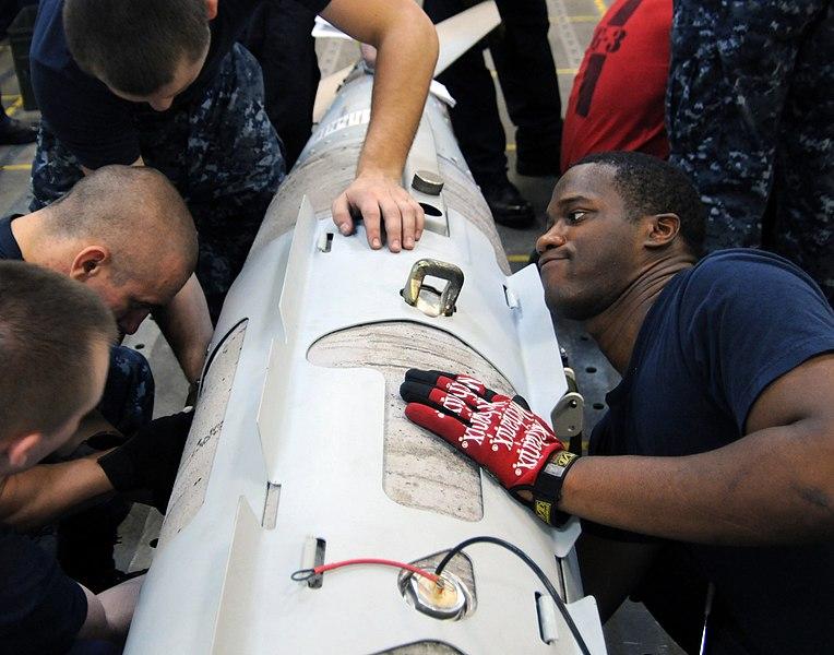 File:US Navy 110720-N-FE409-194 Aviation Ordnanceman Airman Demetrios Sparkman assembles a Joint Direct Attack Munitions (JDAM) weapon aboard the aircra.jpg