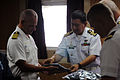 US Navy 110727-N-XD424-131 Capt. Alberto A. Cruz, right, a gift to Capt. Jeffrey James.jpg