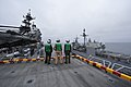US Navy 110914-N-KS651-134 Marines assigned to the 11th Marine Expeditionary Unit (11th MEU) watch as the amphibious assault ship USS Makin Island.jpg