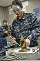 US Navy 110914-N-ZZ447-007 Machinist's Mate Fireman Recruit Elaina Tirado practices maintenance procedures in the valve and flange lab.jpg