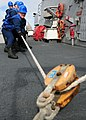 US Navy 111206-N-ZF681-449 Sailors heave a fuel line aboard the guided-missile destroyer USS Halsey (DDG 97) during a replenishment at sea.jpg