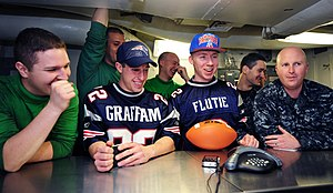 US Navy 111220-N-KQ416-059 Sailors talk to New England Patriots Head Coach Bill Belichick during a holiday morale phone call aboard the Nimitz-Clas.jpg