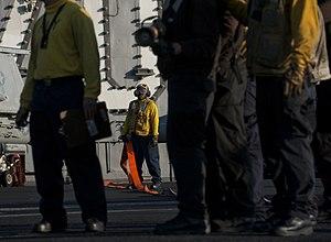 US Navy 120120-N-DR144-410 A Sailor mans a hose during a flight deck firefighting drill.jpg