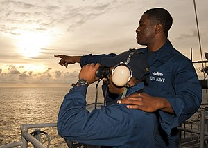 US Navy 120124-N-FI736-001 Sailors scan the horizon for surface contacts while on watch aboard the aircraft carrier USS Enterprise (CVN 65).jpg