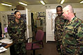 V Corps Command Sgt. Maj., James Rosacker (right) receives an operations briefing from Staff Sgt. Melvin Cooper (center) and Sgt. Shavonne Walker (left) at the 38th Personnel Service Battalion, Camp Bondsteel on 030326-A-GY686-002.jpg