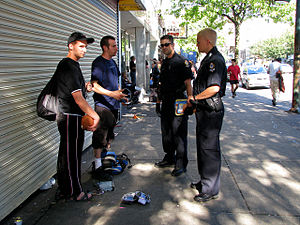 Possession of stolen goods - Officers of the Vancouver Police Department checking for stolen goods at a flea market