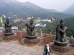 "Tian Tan Buddha - ""The Offering of the Six Devas"": Buddhistic statues praising and making offerings to the Tian Tan Buddha. Po Lin Monastery can be seen in the background."
