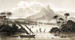 An etching showing a harbour as viewed from the sea, with small boats in the foreground.