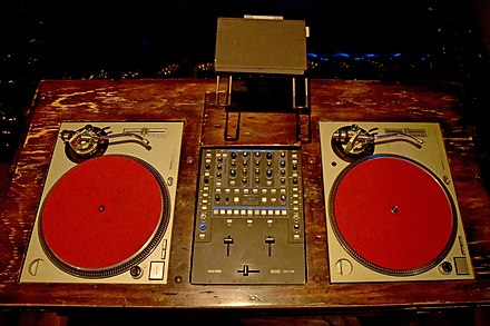 Classic DJ Station. A DJ mixer is placed between two Technics SL-1200 MK 2 turntables. Vintage DJ Station 2019 by Glenn Francis.jpg