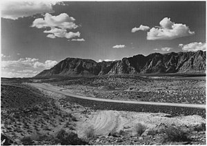 Arrowhead Trail (auto trail) - A 1929 photo of the Arrowhead Trail, now Old Hwy 91, about 5 miles west of Santa Clara, Utah. A section of the Vermilion Cliffs is in the background to the north.