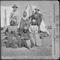 Winema or Tobey Riddle, a Modoc, standing between an agent and her husband Frank (on her left), with four Modoc women in - NARA - 533247.tif